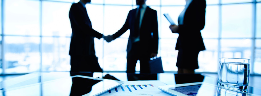 business people shaking hands at meeting