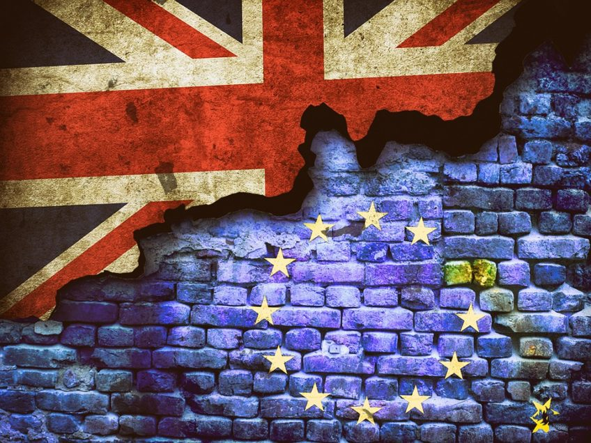 brick wall with half eu flag overlay and half union jack overlay