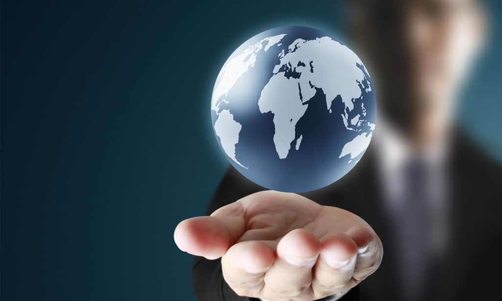 man holding out hand with a floating globe graphic