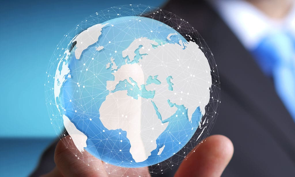man pointing to a globe graphic