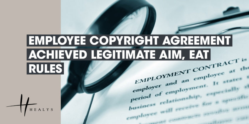 image of a magnifying glass over an employment contract