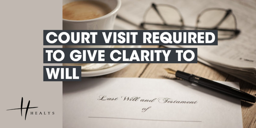 last will and testament document, with glasses, a pen and cup of tea n the table next to it