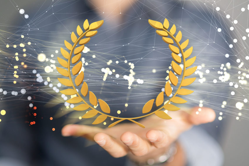 image of a man holding his hand out with an award symbol in front