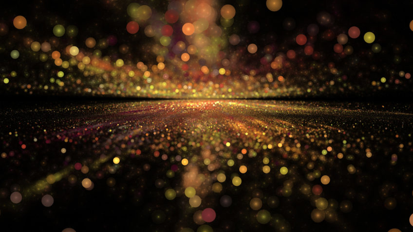 image of gold glitter against a black background