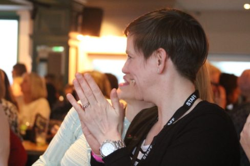 image of healys staff member clapping hands