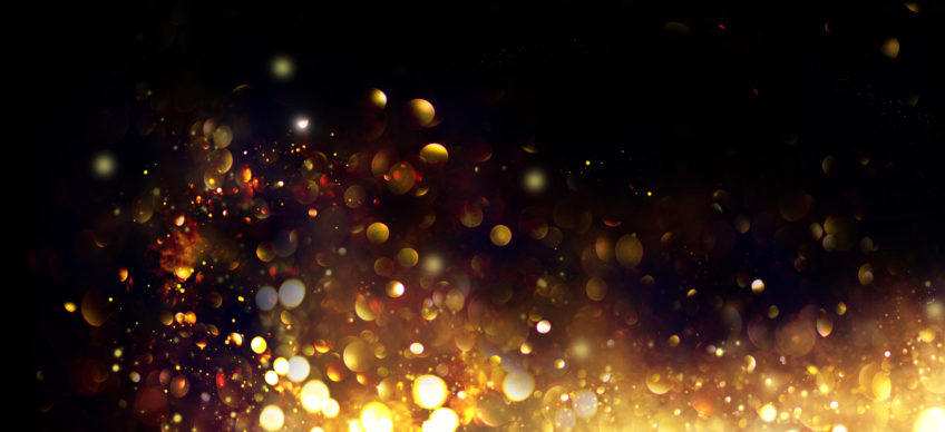 Image of golden glitter on black background
