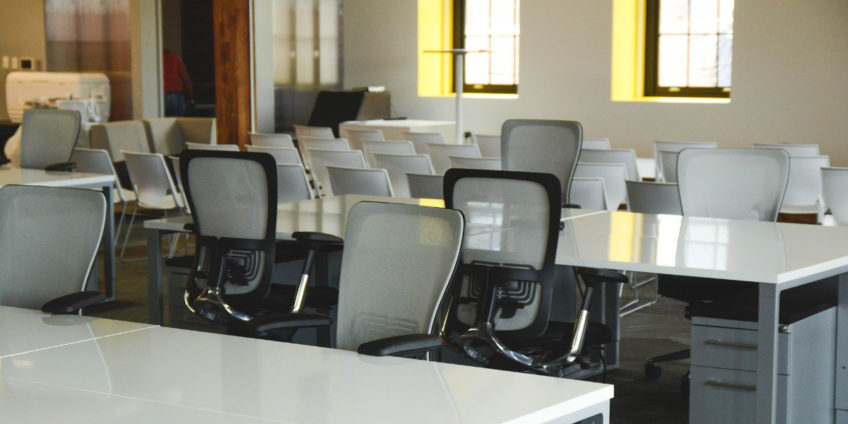 Image of empty desks and chairs in classroom