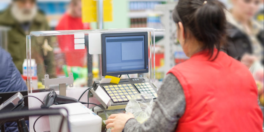 woman working at supermarket checkout