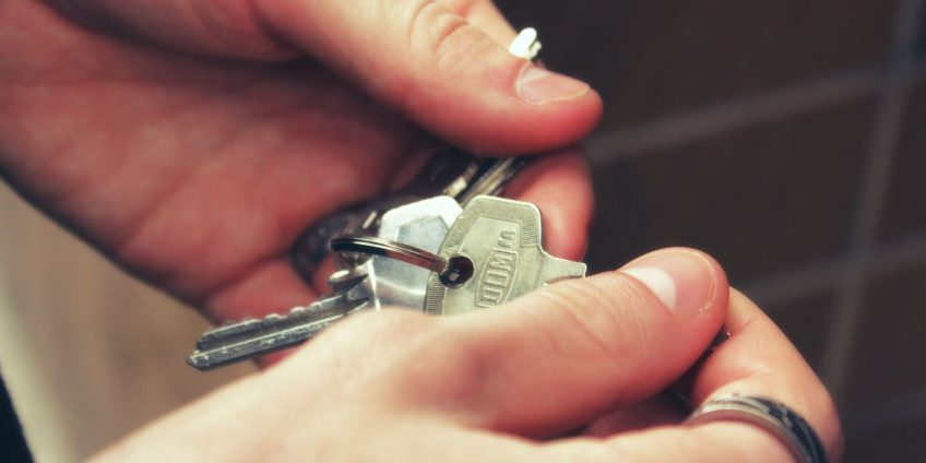 close up of hands holding keys