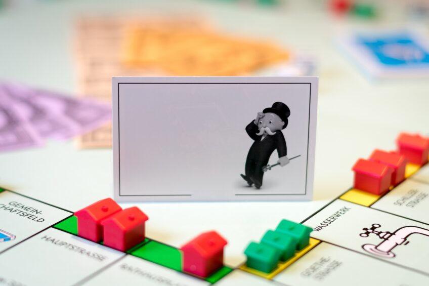 image of monopoly board with a card of mr monopoly