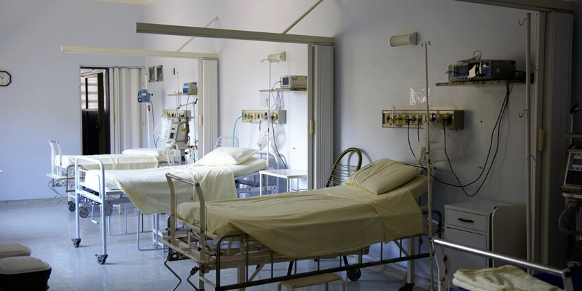 hospital ward with empty hospital beds